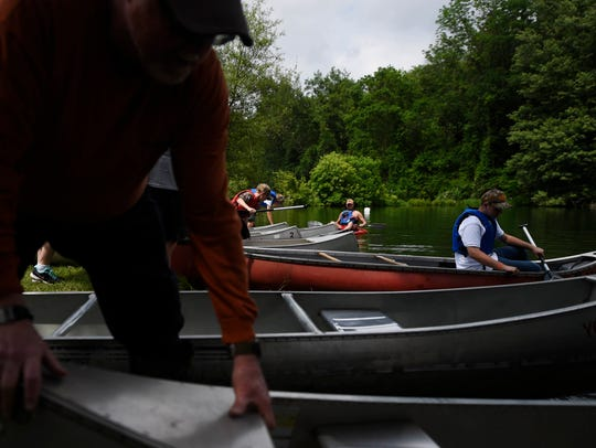 Kids head out in canoes to practice paddling during