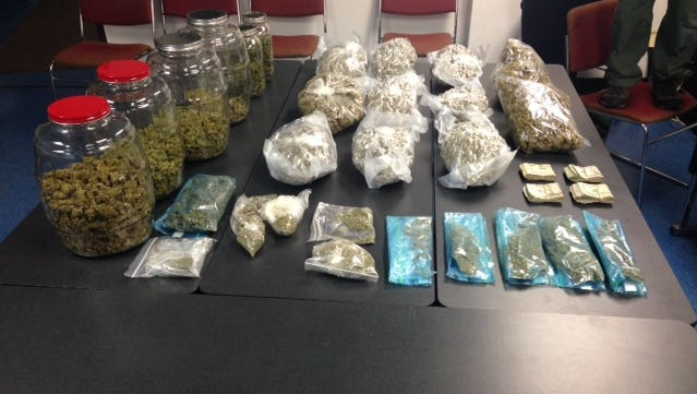 Authorities said they seized 15 pounds of pot and $8,400 in cash Saturday at a home in Stony Point.