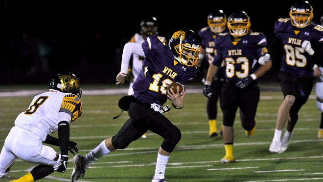 Wylie High School quarterback Sam King scrambles with the ball during Friday's game against Snyder High School Oct. 27, 2017. Wylie won, 27-7.