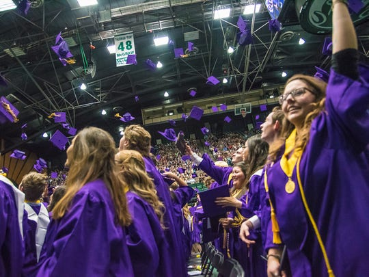 Students toss their graduation caps in the air during Fort Collins High School's graduation ceremony on Saturday, May 26, 2018, at Moby Arena in Fort Collins, Colo.