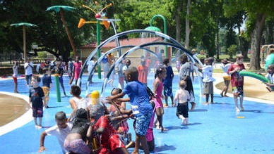 Kids play at the Alexandria City Park splash pad. The city's three splash pads will open May 1 for the summer season.