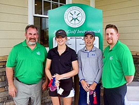Two young golfers captured a memorial tournament recently