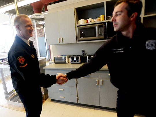 Scott Wolverton, who's expected to be confirmed as Shreveport's next fire chief, greets firefighter Mitch Bertrand at Central Fire Station.