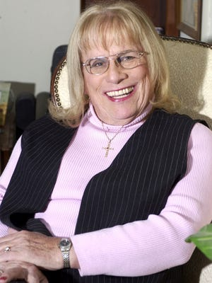 In this Monday, Feb. 27, 2006, file photograph, Lily McBeth, formerly William McBeth, poses for a photo in her home in Little Egg Harbor Township, N.J. McBeth, a teacher whose battles with school boards in conservative areas of New Jersey made her a reluctant symbol of the transgender rights movement, died Sept. 24, 2014, according to her daughter. McBeth was 80.