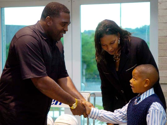 Daedra Charles-Furlow introduces her seven year-old son Anthonee Furlow to former UT football player Todd Kelly during a dinner for inductees to the Women's Basketball Hall of Fame on Friday.