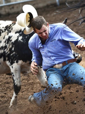Dane Browning loses his hat in the steer wrestling event at last year's Ventura County Fair PRCA rodeo. Admission to the rodeo is free with a paid admission to the fair.