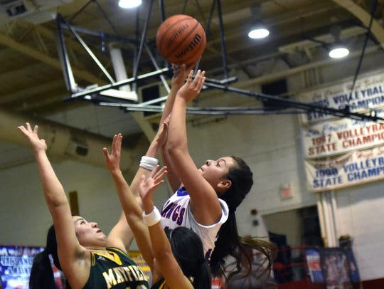Las Cruces High's Nikki Aragon goes up for a shot over