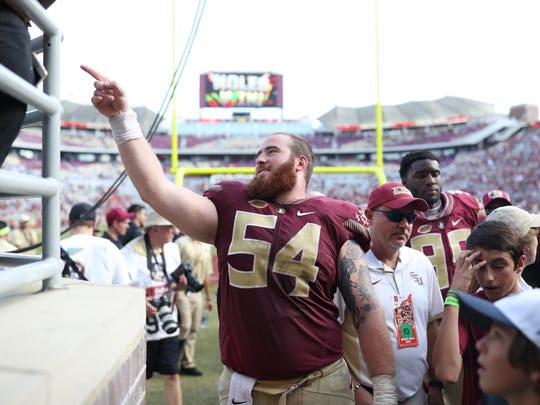 FSU's Alec Eberle celebrates with fans as he walks