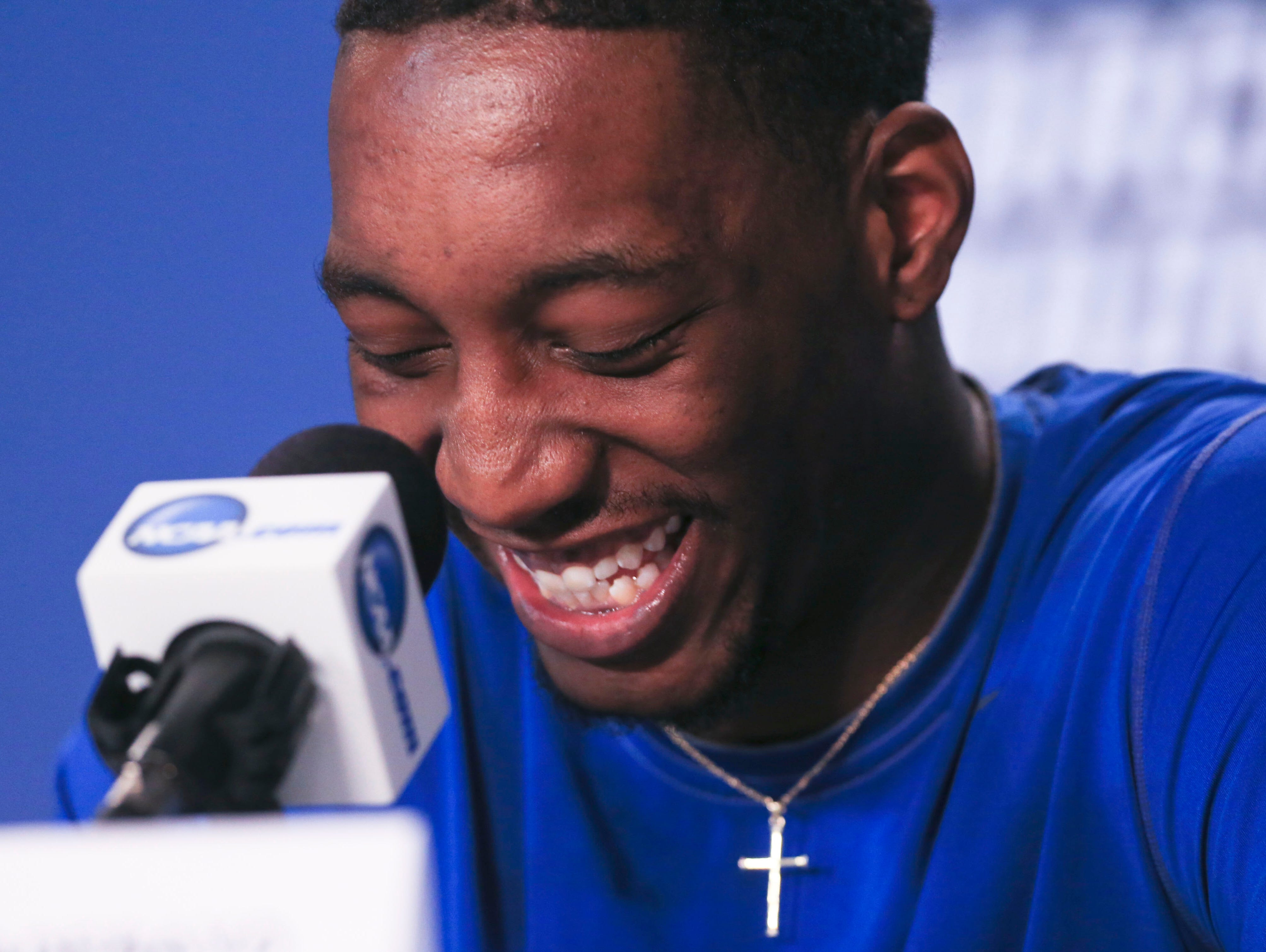 Kentucky's Bam Adebayo laughs after an answer by teammate De'Aaron Fox during a press conference Saturday afternoon in Indy.