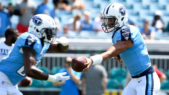 Tennessee Titans quarterback Marcus Mariota (8) hands off to running back DeMarco Murray (29) during warmups before the game against the Jaguars at EverBank Field Sunday, Sept. 17, 2017 in Jacksonville , Fl.