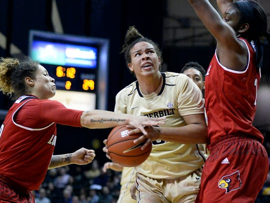 Louisville guard Briahanna Jackson (0) knocks the ball