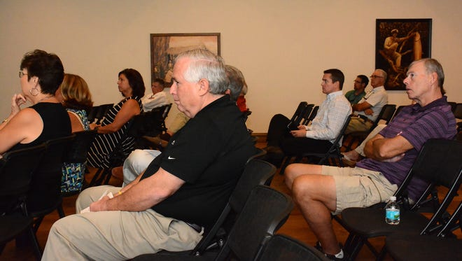 Realtors' Association president-elect Mike O'Rourke, center, listens to the presentations. The Marco Island Area of Realtors held its second annual Economic Summit Wednesday afternoon in Rose Auditorium at the Historical Museum.