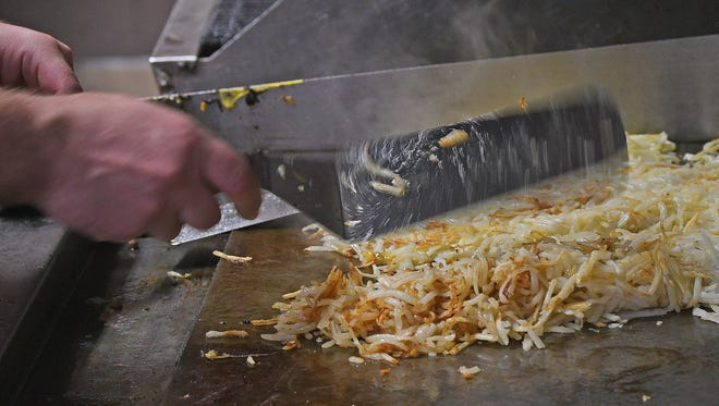 Hashbrowns are cooked during breakfast time Wednesday morning at Diner 39 in Shelby.