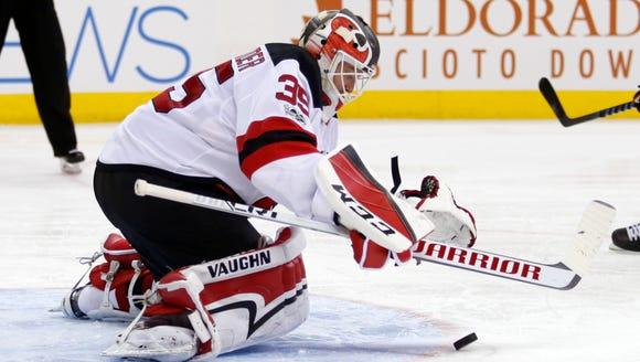 New Jersey Devils goalie Cory Schneider makes a stop