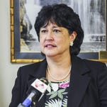 Guam Attorney General Elizabeth Barrett-Anderson speaks during a press conference at her office on April 15.