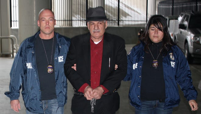Mahmoud Bazzi is escorted by two Immigration and Customs Enforcement officers Jan. 30, 2015. Bazzi, a native of Lebanon, was deported after admitting that he entered the U.S. illegally and lied to get immigration benefits. Irish authorities accuse Bazzi of abducting  three Irish U.N. soldiers in 1980, torturing and killing two, and wounding the third.