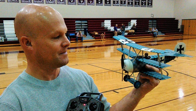 The Mount Vernon High School gym provides plenty of open air space for Dan Vance of North Liberty and others from around the area to fly indoor radio controlled planes, such as Vance's triplane Fokker shown here.