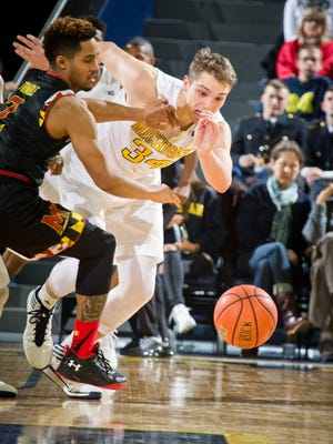 Michigan forward Mark Donnal (34) continued development has left Moritz Wagner fighting for playing time.