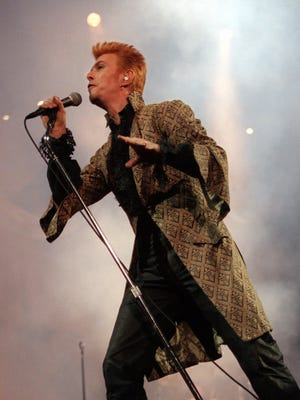 Entertainer David Bowie performs during a concert celebrating his 50th birthday on Jan. 9, 1997, at Madison Square Garden in New York.