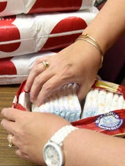 Diapers are being sorted Thursday, June 16, 2016 at Centrral Presbyterian Church. The charity provides disposable diapers for moms who can't afford them.