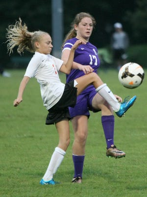 South Gibson's Aly Goodman (2) challenges Trinity Christian Academy's Alyssa Goehring (17) at Medina Community Park in Medina, Tenn., on Tuesday, Aug. 16, 2016.