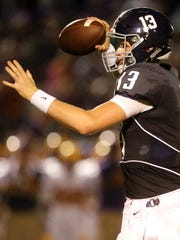 Siegel's quarterback Brendan Crowell (13) drops back