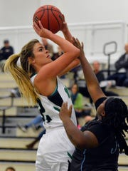 In this photo, Dallastown grad Katie McGowan shoots over a Wesley College defender. McGowan tied for a game-high 14 points in York's season-opening win over McDaniel College on Wednesday, Nov. 15.