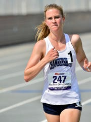 Abby Yourkavitch of Chambersburg takes the lead in the 3200m run. Mid Penn Track & Field Championships were held Saturday, May 12, 2018 at Chambersburg's Trojan Stadium.