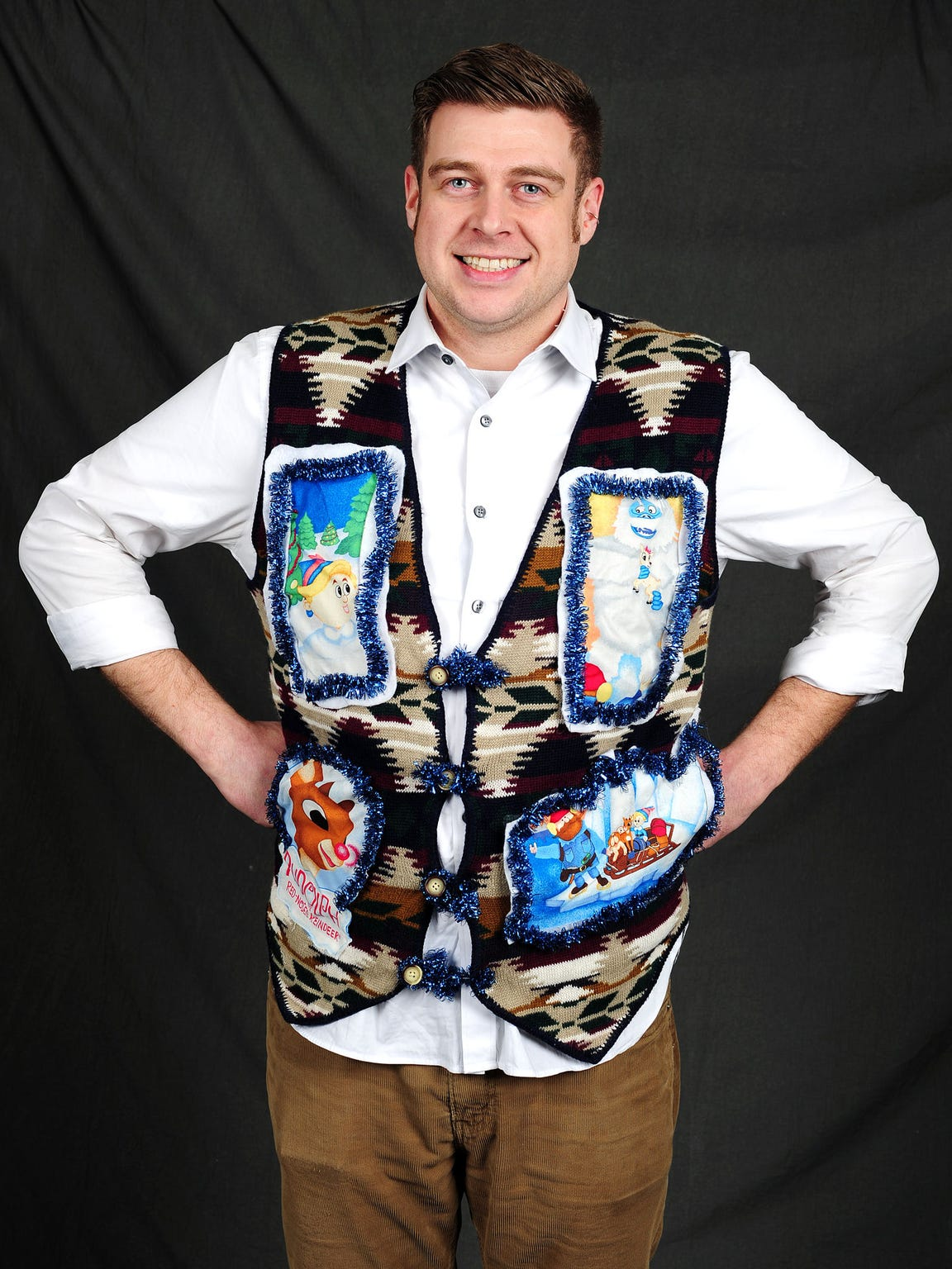 David Ballantyne displays his ugly Christmas sweater,