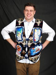 David Ballantyne displays his ugly Christmas sweater, which features characters from the iconic holiday show Rudolph the Red-Nosed Reindeer.
