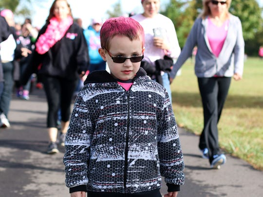Pam Strear's son, TJ, walks behind his mom. About 400 people participated in the Making Strides Walk on Sunday Oct. 4.
