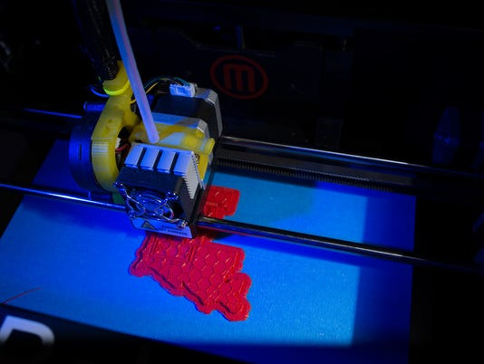 635960699430729704-3D-printer-at-the-Louisiana-Tech-Thingery-whirs-and-hums-in-the-rapid-prototyping-lab..jpg