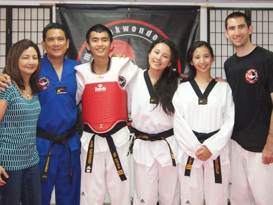 Master Noly Caluag, fifth degree black belt and owner of Guam Taekwondo Center taking a photo with his family. From left to right, wife Malu, Noly, Jed, Michelle Caluag, Stephanie Caluag-Keenan and her husband Jonathan Keenan.