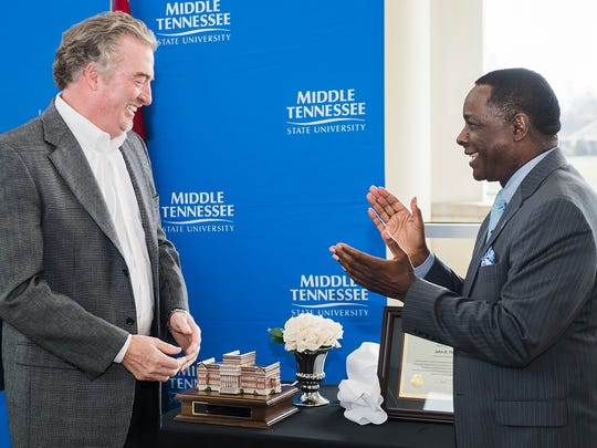 Philanthropist and homebuilder John Floyd, left, smiles