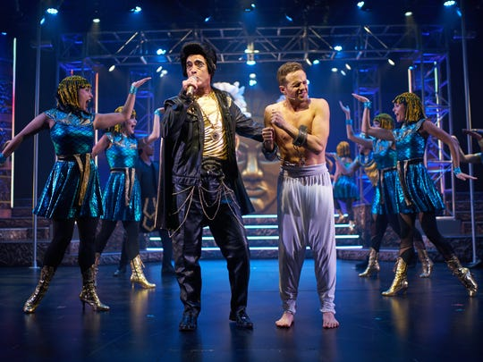 """Scott Treadway as Pharoah. ;eft. with Lance Bordelon as Joseph and company in """"Joseph and the Amazing Technicolor Dreamcoat"""" at Flat Rock Playhouse."""