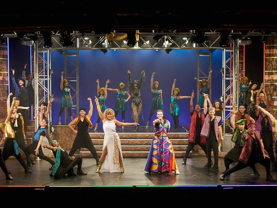 """Jessica Crouch, center, as the Narrator and Lance Bordelon as Joseph and company in """"Joseph and the Amazing Technicolor Dreamcoat"""" at Flat Rock Playhouse."""