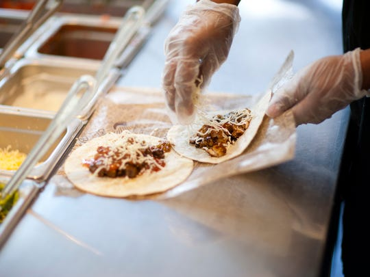 Build-your-own tacos at Chipotle Mexican Grill come in crisp or soft shell versions.