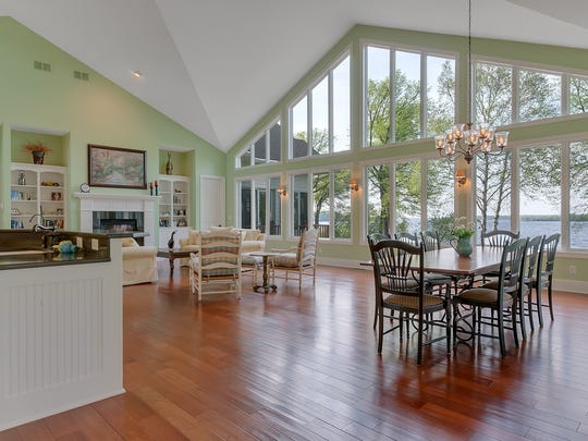 The open floor plan allows family members and guests to relax, eat and mingle all in the great room that overlooks the lake.