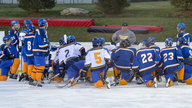 Mahopac coach Chris Lombardo sets up the first drill Tuesday at practice.