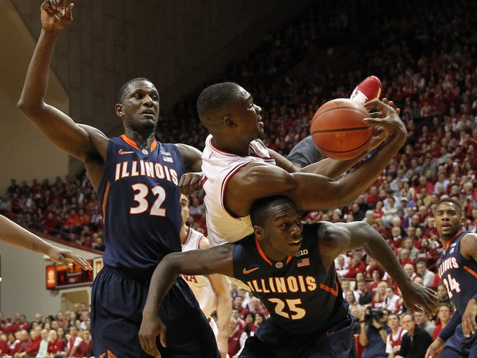 Jan 26, 2014; Bloomington, IN, USA; Indiana Hoosiers forward Noah Vonleh (1) lands on the back of Illinois Fighting Illini guard Kendrick Nunn (25) in front of Illini forward/center Nnanna Egwu (32) during the first half at Assembly Hall. Mandatory Credit: Pat Lovell-USA TODAY Sports