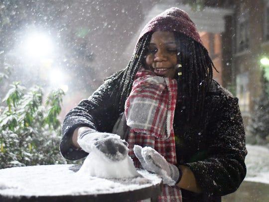 Southern Miss junior Maya Caradine makes a snowball