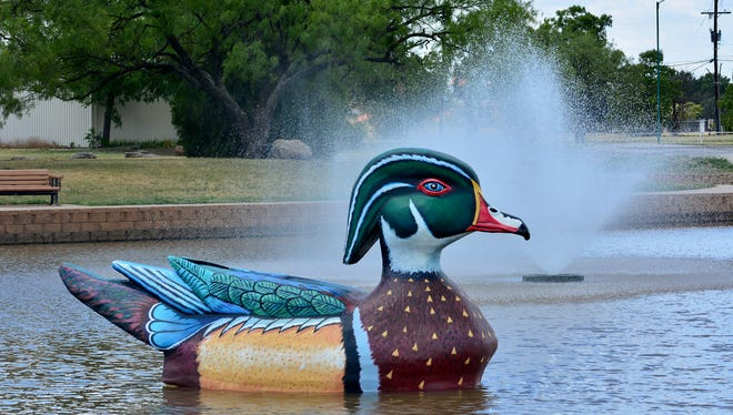 """""""Wally the Wood Duck"""" landed Tuesday on Lake Weeks Park Pond at the Northwest Texas Field and Stream off Southwest Parkway. Area artist Ralph Stearns and his brother Richard worked on the sculpture for four months."""