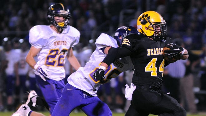 Paint Valley's Teagan McFadden (44) is chased by Unioto's Andrew Oyer on a long yardage run in the first half of a 2014 contest at Paint Valley High School. McFadden will be wearing No. 16 in honor of his cousin, Mady, during the 2015 season.