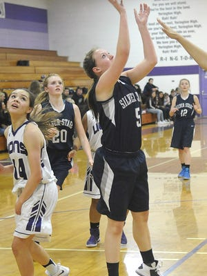Silver Springs' Dominique Connolly sets up for a two-pointer.