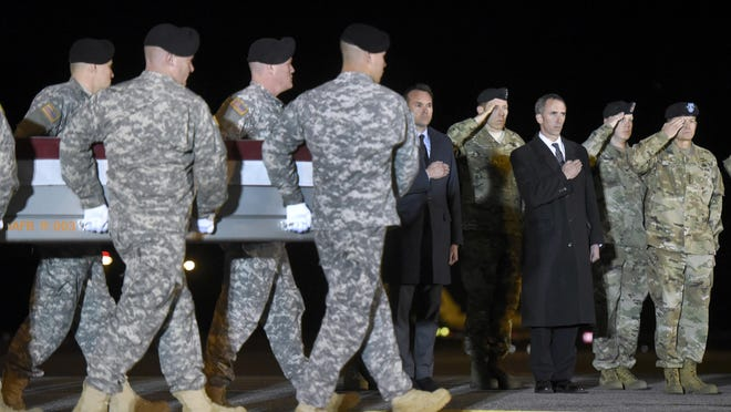 An Army team carries the remains of Sgt. 1st Class Matthew C. Lewellen in 2016 at Dover Air Force Base, Del.