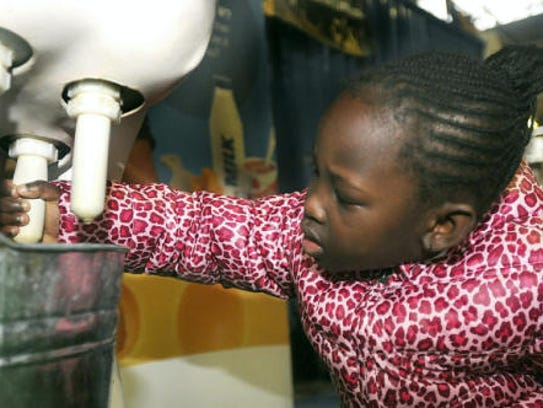 Demiana Evans milks an artificial cow during the final