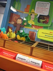 """The Produce Stand at the bilingual, interactive exhibit """"Curious George: Let's Get Curious!"""" which opens Saturday at Impression 5 Science Center."""