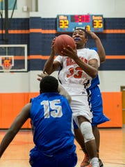 Delmar's Kavon Trader shoots against Woodbridge.