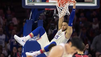 Philadelphia 76ers guard Ben Simmons (25) dunks against the Miami Heat during the second quarter in game five of the first round of the 2018 NBA Playoffs at Wells Fargo Center.