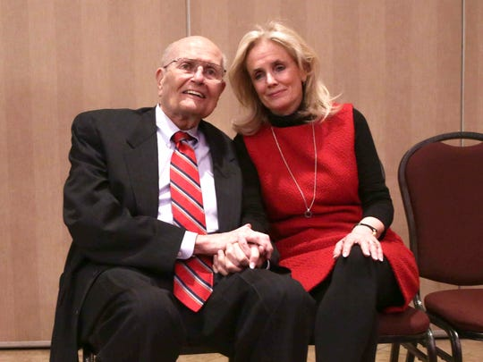 U. S. Rep. John Dingell, 87, and his wife Debbie Dingell pose for a photo after a luncheon where Dingell addressed his retirement from being the longest-serving member of Congress on Feb. 24, 2014.